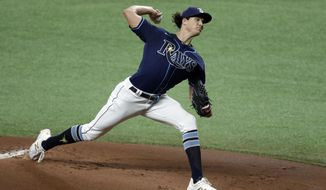 Tampa Bay Rays' Tyler Glasnow pitches to the Atlanta Braves during the first inning of a baseball game Monday, July 27, 2020, in St. Petersburg, Fla. (AP Photo/Chris O'Meara)