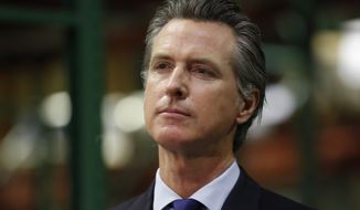 "Gov. Gavin Newsom listens to a reporter's question during a news conference in Rancho Cordova, Calif., Friday, June 26, 2020. Democrats who control California's state Legislature on Monday proposed a $100 billion economic stimulus plan that relies on what they are calling ""future tax vouchers"" along with speeding up other spending during the coronavirus pandemic. (AP Photo/Rich Pedroncelli, Pool, File)"