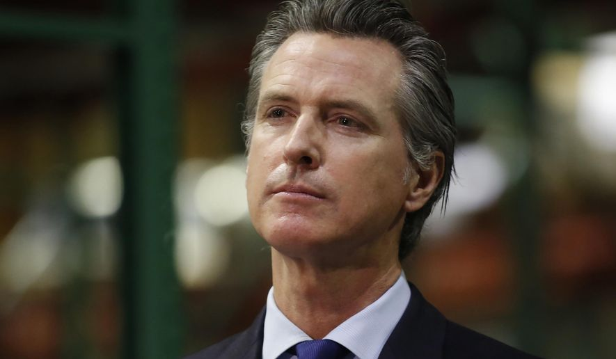 """Gov. Gavin Newsom listens to a reporter's question during a news conference in Rancho Cordova, Calif., Friday, June 26, 2020. Democrats who control California's state Legislature on Monday proposed a $100 billion economic stimulus plan that relies on what they are calling """"future tax vouchers"""" along with speeding up other spending during the coronavirus pandemic. (AP Photo/Rich Pedroncelli, Pool, File)"""