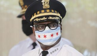 Chicago Police Superintendent David Brown wears a face mask at a news conference on Monday, July 27, 2020 in Chicago. Police are reporting a drop in homicides and shooting incidents after the department rolled out two units designed to combat gun violence and ensure protests remain peaceful. The city reported three homicides over the weekend compared to 12 the weekend before. It was the first weekend that the 300-member Community Safety Team was dispatched to communities on the West and South sides where there has been an uptick in violent crime. (AP Photo/Teresa Crawford)