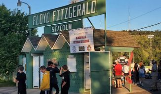 Fans file into Floyd Fitzgerald Stadium on Thursday, July 17, 2020, to see some of the final games in the stadium before a $5 million renovation project begins in Rapid City, S.D. (Kent Bush/Rapid City Journal via AP)
