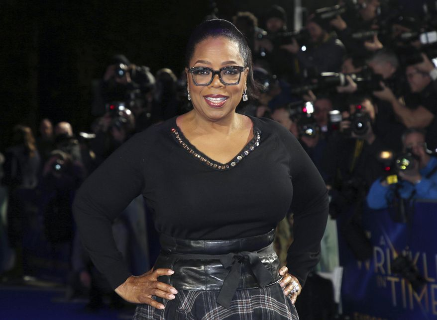 """In this March 13, 2018, file photo, actress Oprah Winfrey poses for photographers upon arrival at the premiere of the film """"A Wrinkle In Time"""" in London. (Photo by Joel C Ryan/Invision/AP, File)"""