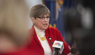 Kansas Gov. Laura Kelly talks at a press conference Monday, July 27, 2020, in Topeka, Kan., where she considered moving the state back to Phase 2 of reopening if COVID-19 cases continue to rise. (Evert Nelson/The Capital-Journal via AP)