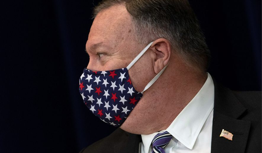 Secretary of State Mike Pompeo wears a face mask as he leaves after a news conference at the State Department Tuesday, July 28, 2020, in Washington. (Brendan Smialowski/Pool via AP) (ASSOCIATED PRESS)