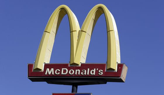 This Oct. 17, 2019, file photo shows a McDonald's sign along Interstate 40/85 in Burlington, N.C. (AP Photo/Gerry Broome, File)