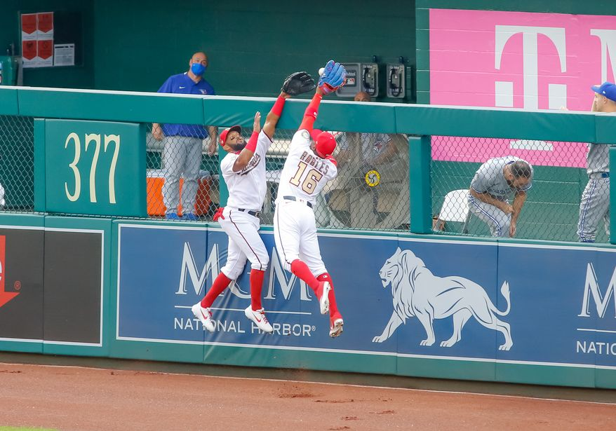 Washington Nationals outfielders Emilio Bonifacio (left) and Victor Robles get in each other's way and allow a ball hit by Vladimir Guerrero Jr. of the Toronto Blue Jays over the wall for a home run on Tuesday, July 28, 2020 at Nationals Park in Washington, D.C. (Photo by All-Pro Reels)