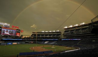 A rainbow is seen over Nationals park as the Washington Nationals compete against the Toronto Blue Jays during the eighth inning of a baseball game, Tuesday, July 28, 2020, in Washington. (AP Photo/Nick Wass)