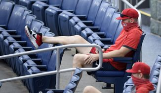 Washington Nationals' Stephen Strasburg (37) watches from the stands during the first inning of a baseball game against the Toronto Blue Jays, Tuesday, July 28, 2020, in Washington. (AP Photo/Nick Wass)  **FILE**