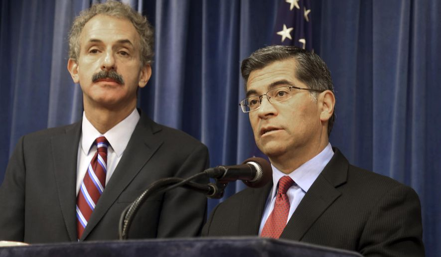FILE - California Attorney General Xavier Becerra, right, and Los Angeles City Attorney Mike Feuer appear at a news conference in Los Angeles, Calif., Tuesday, Feb. 6, 2018. California on Tuesday, July 28, 2020 became the latest state to sue President Donald Trump over his executive order excluding people in the U.S. illegally from being counted when congressional districts are redrawn after this year's census. The nation's most populous state stands to lose a congressional seat if the president's order stands, according to an analysis by the Pew Research Center. He was joined by the cities of Long Beach, Los Angeles and Oakland and the Los Angeles Unified School District in arguing that the move is unconstitutional and did not follow proper legal procedures. (AP Photo/Mike Balsamo, File)