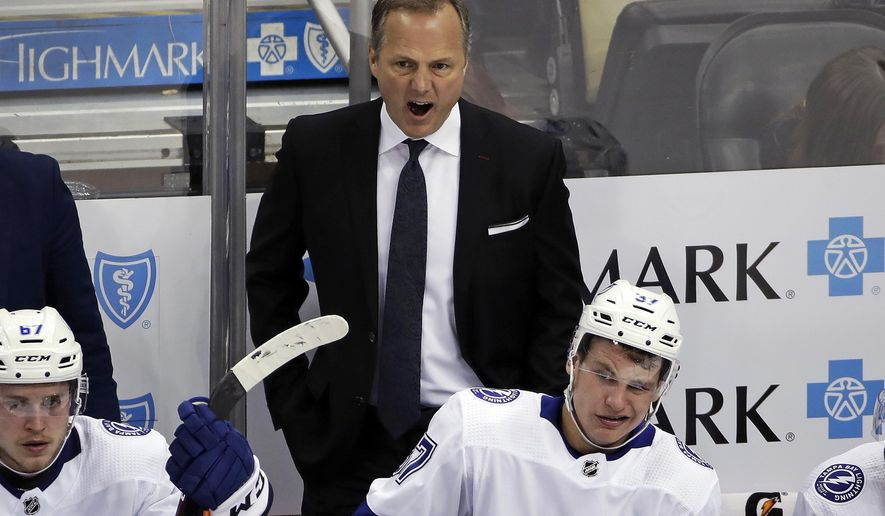 FILE - In this Feb. 11, 2020, file photo, Tampa Bay Lightning head coach Jon Cooper yells instructions during the third period of an NHL hockey game against the Pittsburgh Penguins in Pittsburgh. When Todd Reirden and Jon Cooper spent four months looking over video of the teams they coached this season, they saw almost polar opposites. Reirden's Washington Capitals started hot before their defensive game slipped. Cooper's Tampa Bay Lightning took a while to warm up, then won 14 of 21 games before the NHL season was halted in mid-March because of the COVID-19 pandemic. (AP Photo/Gene J. Puskar, File)