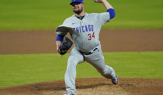 Chicago Cubs starting pitcher Jon Lester (34)  throws during the first inning of a baseball game against the Cincinnati Reds at Great American Ballpark in Cincinnati, Monday, July 27, 2020. (AP Photo/Bryan Woolston)