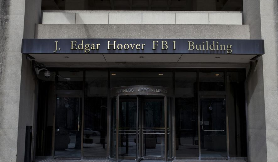 In this March 4, 2019, file photo, the J. Edgar Hoover FBI Building is seen in Washington. (AP Photo/Alex Brandon, File)
