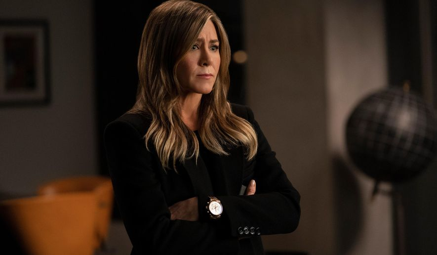 """This image released by Apple TV Plus shows Jennifer Aniston in a scene from """"The Morning Show."""" Aniston was nominated for an Emmy Award for outstanding lead actress in a drama series on Tuesday, July 28, 2020. (Apple TV Plus via AP)"""