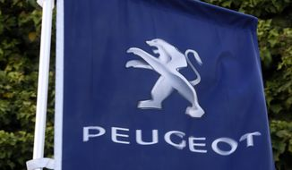 FILE - In this file photo dated Wednesday, Dec.18, 2019, the logo of French car maker Peugeot is pictured in Paris.  The maker of Peugeot and Citroen cars, PSA Group, said Tuesday July 28, 2020, that it made a profit in the first six months of the year even as the coronavirus pandemic caused a deep drop in sales. (AP Photo/Thibault Camus, FILE)