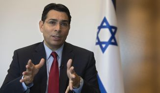 Israel's outgoing ambassador to the United Nations Danny Danon speaks during an interview with The Associated Press in the central Israeli city of Ra'anana, Tuesday, July 28, 2020. Danon affirmed the country's bond with the Trump administration, dismissing notions that Israel would pay a price for its tight ties to the divisive president should he be defeated in November. Danon said he was relieved that the more radical forces in the Democratic Party failed to win the party's nomination and that Israel could prosper with either Trump or Joe Biden in the White House. (AP Photo/Sebastian Scheiner)