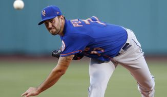 New York Mets' David Peterson pitches during the first inning of a baseball game against the Boston Red Sox, Tuesday, July 28, 2020, in Boston. (AP Photo/Michael Dwyer)