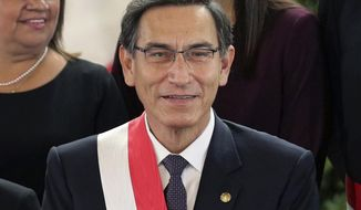 FILE - In this Oct. 3, 2019 file photo, Peru's President Martin Vizcarra smiles after the swearing-in ceremony of his new cabinet at the government palace in Lima, Peru. On July 28, 2020, the anniversary of independence, Vizcarra tried in a televised speech to galvanize a country battered, like so many others around the world, by economic calamity and mass death from the new coronavirus. (AP Photo/Martin Mejia, File)