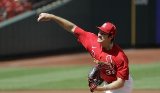 St. Louis Cardinals starting pitcher Miles Mikolas throws during the first inning of an exhibition baseball game against the Kansas City Royals Wednesday, July 22, 2020, in St. Louis. (AP Photo/Jeff Roberson)