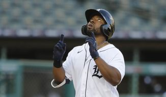 Detroit Tigers' Christin Stewart looks skyward as he approaches home plate after his two-run home run during the third inning of a baseball game against the Kansas City Royals, Tuesday, July 28, 2020, in Detroit. (AP Photo/Carlos Osorio)