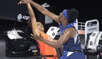 Minnesota Lynx center Sylvia Fowles, right, deflects a shot by Connecticut Sun guard Jasmine Thomas (5) during the second half of a WNBA basketball game Sunday, July 26, 2020, in Bradenton, Fla. (AP Photo/Phelan M. Ebenhack)