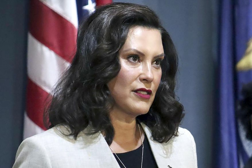 FILE - In a June 17, 2020, file photo provided by the Michigan Office of the Governor, Michigan's Democratic Gov. Gretchen Whitmer addresses the state during a speech in Lansing, Mich. Whitmer was unreceptive Tuesday, July 28, 2020, to Republican-passed legislation that would require public schools to offer in-person instruction to students in kindergarten through fifth grade amid the coronavirus pandemic.(Michigan Office of the Governor via AP, File)