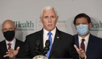 Vice President Mike Pence, center, gestures as he speaks during a news conference with Food and Drug Administration Commissioner Dr. Stephen Hahn, left, and Florida Gov. Ron DeSantis, right, at the University of Miami Miller School of Medicine Don Soffer Clinical Research Center, Monday, July 27, 2020, in Miami. Pence was in Florida to mark the beginning of Phase III trials for a coronavirus vaccine. (AP Photo/Wilfredo Lee)