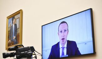 Facebook CEO Mark Zuckerberg testifies remotely during a House Judiciary subcommittee on antitrust on Capitol Hill on Wednesday, July 29, 2020, in Washington. (Mandel Ngan/Pool via AP) ** FILE **