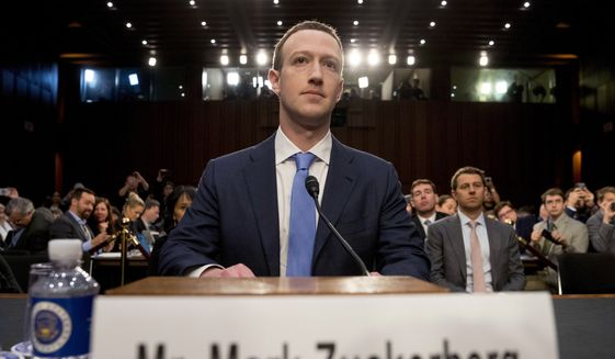 In this Tuesday, April 10, 2018, file photo, Facebook CEO Mark Zuckerberg arrives to testify before a joint hearing of the Commerce and Judiciary Committees on Capitol Hill in Washington. (AP Photo/Andrew Harnik) ** FILE **