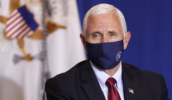 Vice President Mike Pence listens during a roundtable discussion at NC Biotechnology Center where Phase-III trials for a Coronavirus vaccine are underway in Durham, N.C., Wednesday, July 29, 2020. (AP Photo/Gerry Broome)
