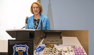 With photographs showing some of the devices recovered by Seattle Police used against officers last weekend, Mayor Jenny Durkan called for calm and a more civil approach to protest that doesn't include destruction or assault, Wednesday, July 29, 2020, in Seattle. The Seattle Police Department showed some of the incendiary devices and other tactical materials confiscated after last Saturday's riot on Capitol Hill. (Dean Rutz/The Seattle Times via AP) ** FILE **