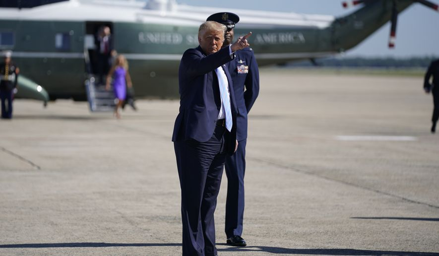 President Donald Trump pauses to point while walking to board Air Force One for a trip to Midland, Texas to visit Double Eagle Energy Oil Rig, Wednesday, July 29, 2020, in Andrews Air Force Base, Md. (AP Photo/Evan Vucci)