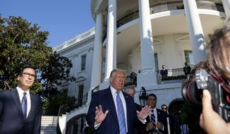 President Donald Trump, accompanied by Treasury Secretary Steven Mnuchin, left, speaks with reporters as he walks to Marine One on the South Lawn of the White House, Wednesday, July 29, 2020, in Washington. (AP Photo/Alex Brandon) ** FILE **