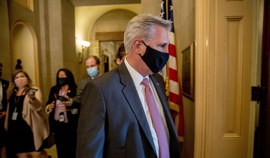House Minority Leader Kevin McCarthy of Calif., walks into a meeting with Republican lawmakers on Capitol Hill in Washington, Wednesday, July 29, 2020, after lawmakers were unable to reach a deal on a new coronavirus relief package. (AP Photo/Andrew Harnik)