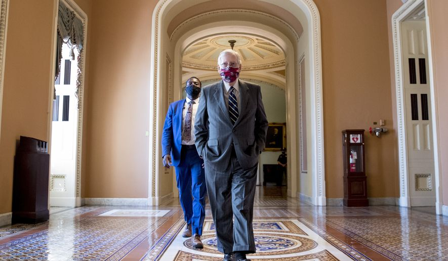 Senate Majority Leader Mitch McConnell of Ky., walks off the Senate floor on Capitol Hill in Washington, Wednesday, July 29, 2020. (AP Photo/Andrew Harnik)