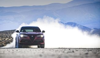 This photo provided by Fiat Chrysler Automobiles shows the 2020 Alfa Romeo Stelvio Quadrifoglio, a high-powered luxury compact crossover with a unique design and comfortable ride. (Courtesy of Fiat Chrysler Automobiles via AP)
