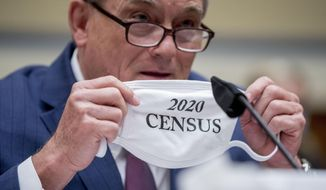 Census Bureau Director Steven Dillingham holds up his mask with the words '2020 Census' as he testifies before a House Committee on Oversight and Reform hearing on the 2020 Census on Capitol Hill, Wednesday, July 29, 2020, in Washington. (AP Photo/Andrew Harnik)