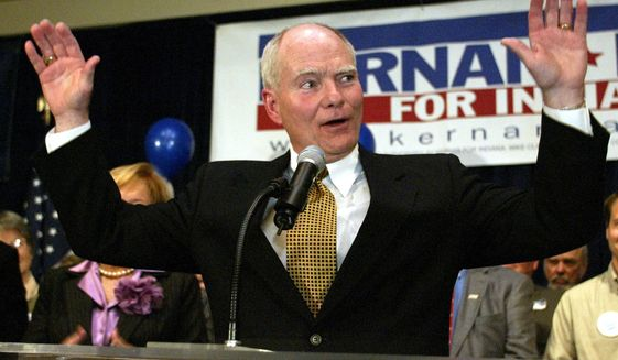 FILE - In this Tuesday, Nov. 2, 2004, file photo, Indiana Gov. Joe Kernan acknowledges the applause of supporters as he concedes to Republican challenger Mitch Daniels in the race for governor in Indianapolis. Former Indiana Gov. Joe Kernan has lost the ability to speak due to Alzheimer's disease and is living in a care facility, according to a report confirmed by his former press secretary Wednesday, July 8, 2020. (AP Photo/Michael Conroy, File)