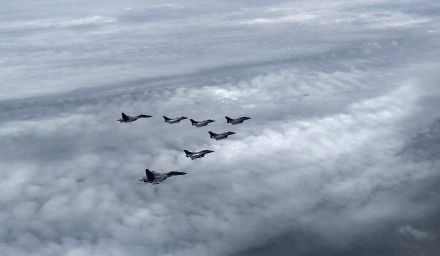This photograph shared by Indian Defence Minister Rajnath Singh in Twitter shows Rafale fighter jets escorted by Indian Air Force Sukhoi Su-30 MKI fighter jets as they enter the Indian airspace Wednesday, July 29, 2020. A first batch of five French-made Rafale fighter jets arrived at an Indian air force base on Wednesday, Indian officials said.(Twitter via AP)