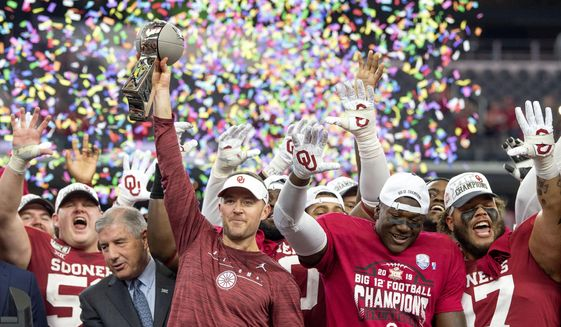 In this Dec. 7, 2019, file photo, Oklahoma head coach Lincoln Riley hosts the Big 12 Conference championship trophy after defeating Baylor 30-23 in overtime in an NCAA college football game in Arlington, Texas. Riley will earn an average of more than $7.5 million a year under a contract extension through the 2025 season. The university's board of regents approved the two-year extension Tuesday, July 28, 2020. (AP Photo/Jeffrey McWhorter) ** FILE **