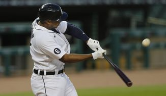 Detroit Tigers' Jonathan Schoop connects for a two-run home run to right field during the fifth inning of a baseball game against the Kansas City Royals, Wednesday, July 29, 2020, in Detroit. (AP Photo/Carlos Osorio)