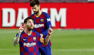 Barcelona's Lionel Messi celebrates his goal against Osasuna during a Spanish La Liga soccer match between Barcelona and Osasuna at the Camp Nou stadium in Barcelona, Spain, Thursday, July 16, 2020. (AP Photo/Joan Monfort)
