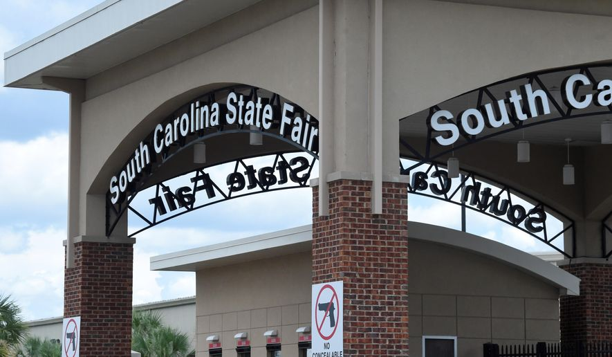 South Carolina's fairgrounds sit mostly empty on Wednesday, July 29, 2020, in Columbia, S.C., as officials with the South Carolina State Fair announced plans to hold a scaled-down, drive-thru version of of the event this year. Fair officials are calling the free event an effort to give the community a bright spot amid the coronavirus pandemic. (AP Photo/Meg Kinnard)