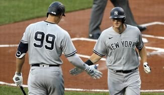 New York Yankees' Aaron Judge (99) greets DJ LeMahieu, right, after LaMahieu hit a solo home run off Baltimore Orioles starting pitcher Asher Wojciechowski during the first inning of a baseball game, Wednesday, July 29, 2020, in Baltimore. (AP Photo/Julio Cortez)