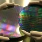The dummies of a 200mm wafer, right, and a 300mm wafer, left, are seen at Advanced Micro Devices Inc. , in Dresden, Germany, Thursday, March 8, 2007.  AMD snared a huge slice of the microprocessor market from archrival Intel Corp., only to find that it might have paid too high a price for its victories. (AP Photo/Matthias Rietschel)