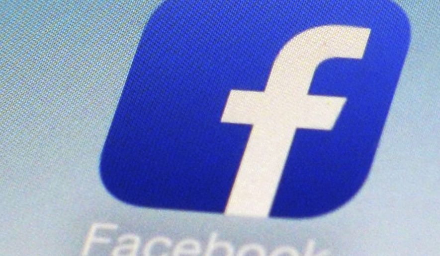 This Feb. 19, 2014, file photo, shows a Facebook app icon on a smartphone in New York. (AP Photo/Patrick Sison, File)