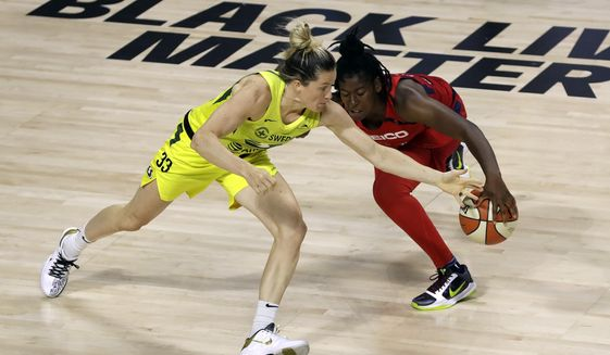 Seattle Storm guard Sami Whitcomb (33) steals the ball from Washington Mystics guard Ariel Atkins (7) during the second half of a WNBA basketball game Thursday, July 30, 2020, in Bradenton, Fla. (AP Photo/Chris O'Meara) ** FILE **