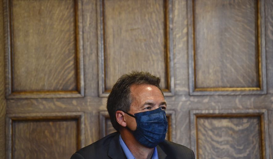 Gov. Steve Bullock gives an update on the state's response to the Covid-19 during a press conference at the State Capitol in Helena, Mont., on Wednesday, July 29, 2020. (Thom Bridge/Independent Record via AP)