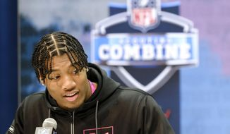 FILE - In this Feb. 27, 2020, file photo, Clemson linebacker Isaiah Simmons speaks during a press conference at the NFL football scouting combine in Indianapolis. Arizona Cardinals coach Kliff Kingsbury has raved about the Clemson star's versatility since he surprisingly landed in the desert after falling to the No. 8 overall selection. (AP Photo/AJ Mast, File)