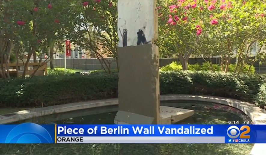 A part of the Berlin Wall displayed at Chapman University in Southern California was painted over in an act of vandalism, officials say. (screen grab via CBSLA)