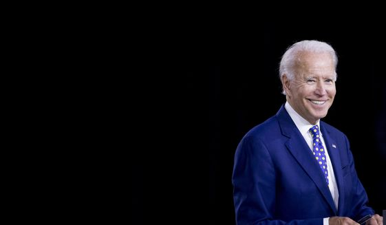 "Democratic presidential candidate former Vice President Joe Biden smiles at a campaign event at the William ""Hicks"" Anderson Community Center in Wilmington, Del., Tuesday, July 28, 2020.(AP Photo/Andrew Harnik) ** FILE **"